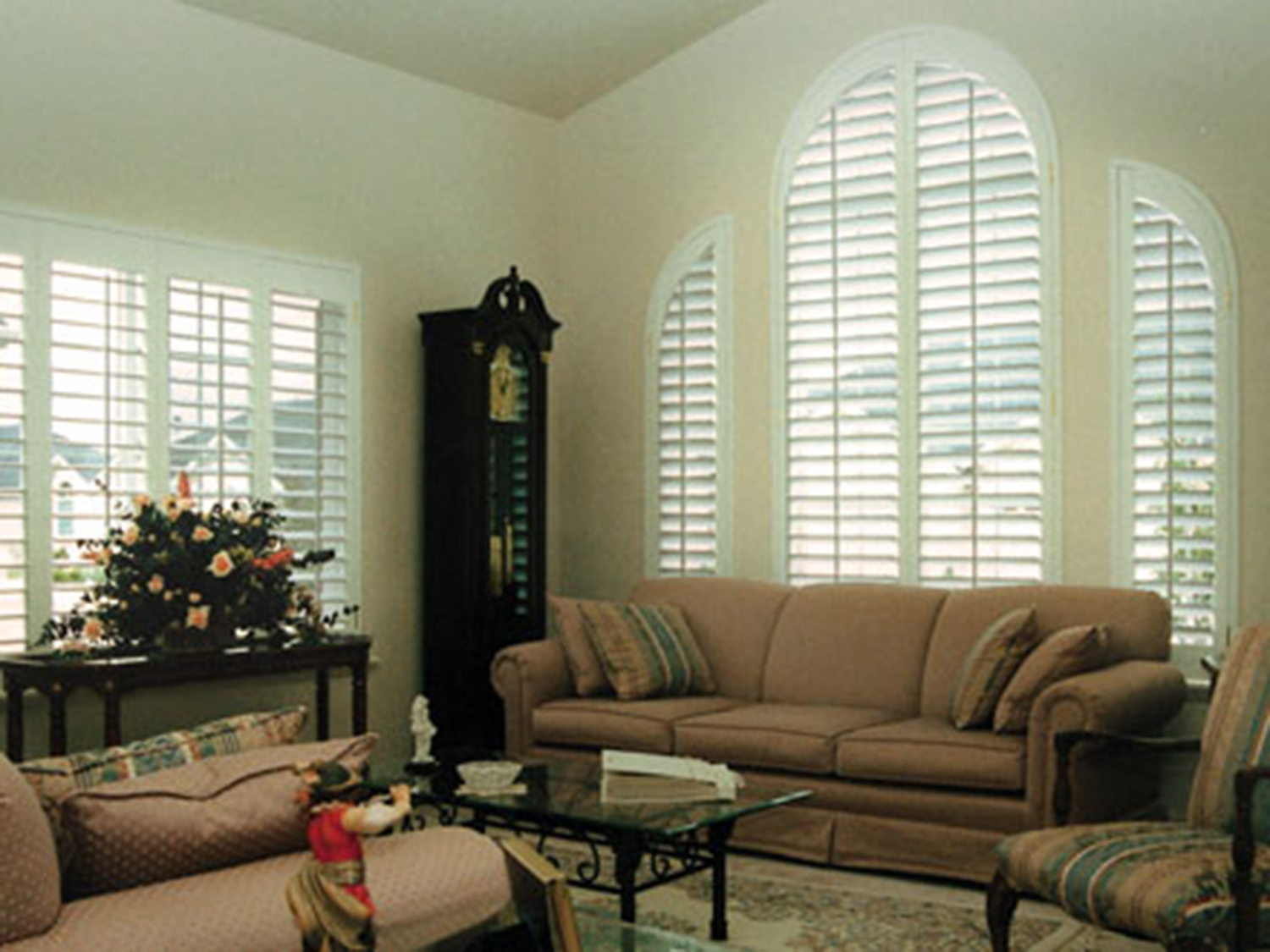 white plantation shutters arched window